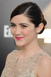 Isabelle Fuhrman attended the premiere of 'The Hunger Games' wearing her hair in a sleek updo featuring looped and pinned sections.