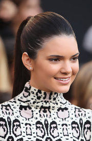 Kendall Jenner wore her ultra-long locks in a sleek ponytail at the premiere of 'The Hunger Games.'
