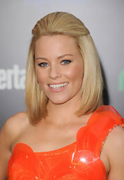 Elizabeth Banks strode the red carpet at 'The Hunger Games' premiere wearing her sleek bob styled in a half-up 'do.