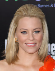 Elizabeth Banks wore a pair of diapason pink ear clips at 'The Hunger Games' premiere.