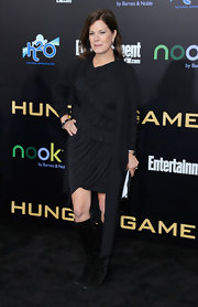 Marcia Gay Harden made a simple dressy outfit into an edgy one by pairing it with knee-high suede boots at 'The Hunger Games' premiere.