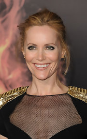 Leslie Mann attended 'The Hunger Games' premiere wearing a pair of 18-carat gold Copernicus stud earrings.