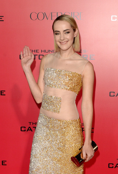 Jena Malone was all aglow at the 'Catching Fire' LA premiere with this gold Jimmy Choo tube clutch and beaded dress combo.