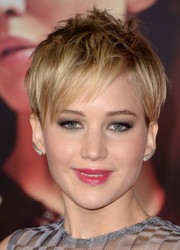 Jennifer Lawrence went for a punk vibe with this short messy 'do at the 'Catching Fire' LA premiere.