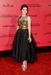 Isabelle Fuhrman paired her dress with sky-high gold platform sandals.