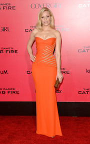 Elizabeth Banks cut a curvy silhouette in an embellished orange strapless gown by Versace at the 'Catching Fire' LA premiere.