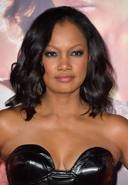 Garcelle Beauvais complemented her leather dress with a wavy 'do for an edgy-glam look during the 'Catching Fire' LA premiere.