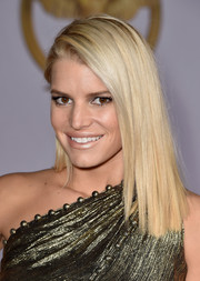 Jessica Simpson went for high shine, pairing a frosted nude lip with her gold gown.
