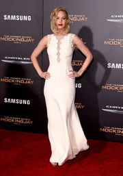 Jennifer Lawrence chose Christian Dior (no surprise there) for her 'Hunger Games: Mockingjay - Part 2' premiere look, which featured subtly embellished shoulders and a scalloped see-through panel down the front.