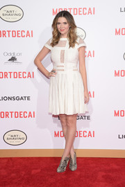 Carly Steel worked the 'Mortdecai' premiere red carpet in a flirty white dress with multiple lace cutouts on the bodice.