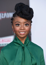 Skai Jackson went for a dazzling finish with a pair of multicolored Swarovski crystal earrings by Sarah Magid Jewelry.