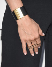 Jennifer Aniston attended the premiere of 'She's Funny That Way' sporting an edgy-glam black and gold cuff.