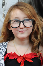 Noah Cyrus tried out the geek chic look in a pair of thick rimmed and oversized glasses.