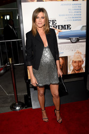 Jennifer Aniston's black Saint Laurent blazer toned down that provocative neckline just a little bit.
