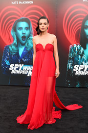 Mila Kunis was a vision in a strapless red empire gown by Valentino at the premiere of 'The Spy Who Dumped Me.'