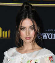 Ana de Armas styled her hair into a top knot with loose tendrils for the premiere of 'Knives Out.'