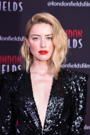Amber Heard lit up her beautiful face with a swipe of red lipstick.
