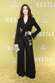 Anne Hathaway looked effortlessly sophisticated in an embroidered tuxedo jumpsuit by Elie Saab at the premiere of 'The Hustle.'