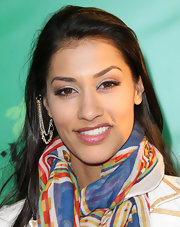 Janina Gavankar swept on a hint of shimmering copper eyeshadow for the premiere of 'Marley.'