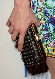 Katie Aselton added a touch of edginess to her red carpet look when she sported this black clutch with gold studs.