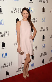 Olga Kurylenko chose this soft blush fishtail dress for her feminine and sophisticated red carpet look.