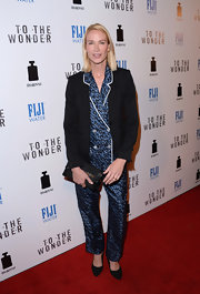 Kelly Lynch opted for a silk leopard-print blouse and matching pants for a sleek and quirky red carpet look.