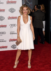 Elsa Pataky chose nude crisscross-strap sandals to complement her dress.