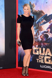 Carrie Keagan amped up the edge factor with a pair of black mesh peep-toe ankle boots.