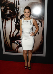 Jessica Parker Kennedy went for a sexy-edgy look with this figure-hugging studded white dress at the premiere of 'Carrie.'