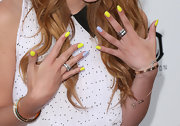 Bella Thorne showed off her neon-yellow and polka-dot nail polish at the premiere of 'The Iceman.'