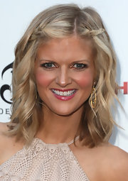 Arden Myrin wore her hair in boho-chic waves with braided accents at the premiere of 'The Iceman.'