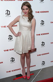 McKaley Miller looked youthful and glam in a textured white cocktail dress at the premiere of 'The Iceman.'