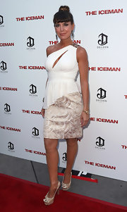 Sandra Vidal paired a gold brocade mini skirt with a slashed one-shoulder top for a sultry look during the 'Iceman' premiere.