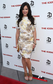 Christa Campbell attended the 'Iceman' premiere wearing a super-chic silk print dress.