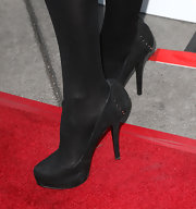 Jess Weixler stepped out in chic black platform pumps paired with tights at the premiere of 'The Iceman.'