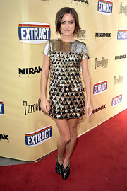 Jessica Stroup wore eye-catching black and gold 'Booties' by Giorgio Armani.