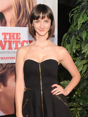 Alexandra paired her strapless zip-up dress with a short bob and blunt cut bangs.