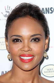 Sharon Leal added an eye-catching shade of gorgeous coral lipstick for the premiere of 'Mansome.'