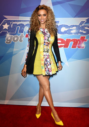 Tyra Banks flaunted her legs in a paneled fit-and-flare mini dress by Stello at the premiere of 'America's Got Talent' season 12.