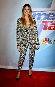 Heidi Klum kept it classic in a leopard-print pantsuit from her Esmara collection at the premiere of 'America's Got Talent' season 12.