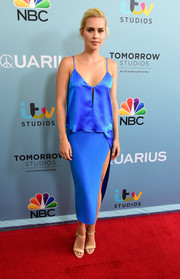 Claire Holt completed her red carpet outfit with nude ankle-strap sandals.