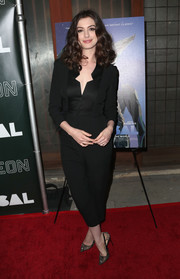 Anne Hathaway styled her outfit with elegant lace pumps by Christian Louboutin.
