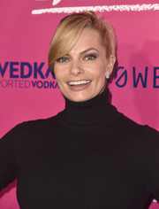 Jaime Pressly attended the premiere of 'I, Tonya' wearing her hair in a twisted bun with side-swept bangs.
