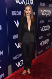 Natalie Portman attended the premiere of 'Vox Lux' wearing a perfectly tailored black suit by Dior Couture.
