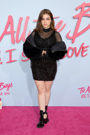 Baby Ariel went for edgy styling with a pair of black cutout boots.