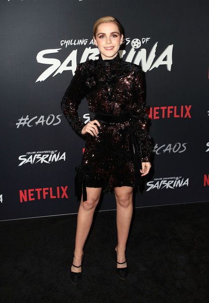 Kiernan Shipka finished off her look with a pair of black mules.