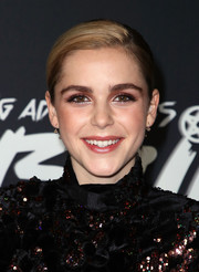 Kiernan Shipka styled her hair into a side-parted updo for the premiere of 'The Chilling Adventures of Sabrina.'