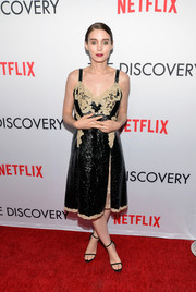 Rooney Mara was a mix of sweet and edgy in a textured black Louis Vuitton dress with nude lace accents during the premiere of 'The Discovery.'