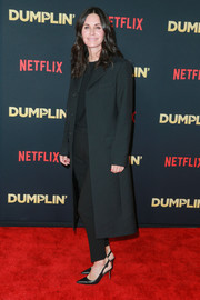 Courteney Cox kept it simple in a black wool coat at the premiere of 'Dumplin'.'