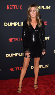 Jennifer Aniston complemented her dress with a pair of black slim-strap sandals.